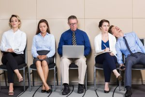 uncomfortable looking people in a waiting room telehealth