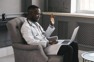 african american doctor consulting with patient via laptop for telehealth